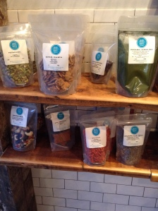 Product retail shelving display for bagged goods (many local, handmade, handcrafted) at Grass Roots Juicery in Brooklyn