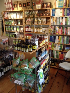Another photo of High Vibe in nyc showing the bookshelf with raw vegan organic recipe books.